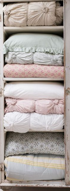 Amazing way to store sheets. Punch up and tie in a few places. Flowers!