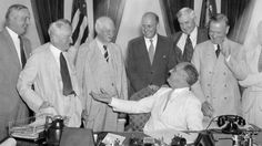 Looking back to when common sense existed: President Franklin D. Roosevelt is shown at the White House as he signed the Glass-Steagall Banking bill, Aug. 23, 1935. From lef to right: Sen. Carter Glass (D-Va.), Duncan U. Fletcher of the Senate Banking Committee; Secretary of the Treasury Henry Morgenthau; Jesse Jones of the R.F.C; and Congressman Henry Steagall (D-Ala.). (AP Photo)