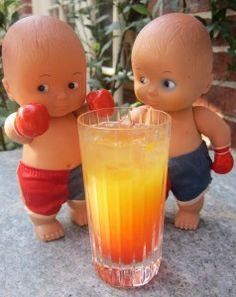 RUM ROLLOVER -- coconut rum, pineapple juice, orange juice, grenadine.