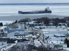 Canadian freighter Algoma Transport transits the Straits of Mackinac after coming up Lake Michigan last night. USCG cutter Katmai Bay escorted her through the Straits.  Feb 3, 2017 - Photo by Clark Bloswick