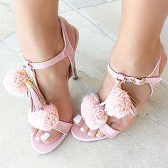Pink Pom Pom heels.