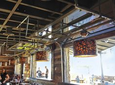 Raynor Glass Garage Doors installed on a Karl Strauss restaurant in San Diego by Automatic Door Specialists.