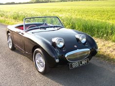 Frogeye, aka 1959 Austin Healy Sprite. I owned a buttercup yellow model with mahogany dash, used to zip around the mountain roads in it, loved it.