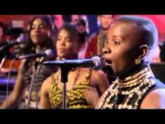 Angelique Kidjo - AGOLO  Africa Africa Africa ~ ! ! ! The great African singer LIVE on stage.  Yowza ! Yep, that's Prince (a guy used used to Prince, but now is a guy in Minnesota) . . .