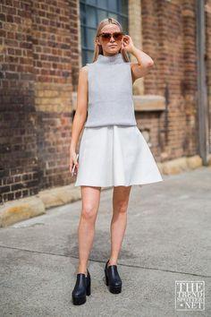Amazing Fashion Week Australia 2015 Street Style - Minimalist perfection. A light gray sleeveless turtleneck worn over a white a-line mini dress + styled with chunky black platform shoes and leopard print sunglasses