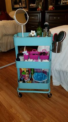 Turn an IKEA Raskog utility cart into a vanity on wheels! I love the idea of putting hair products on the utensil holder hanging off the side.
