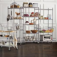 Crafted from heavy-duty, chrome-fi nished steel with shelves, this adjustable pantry organizer easily stores up to pounds of foodstuffs and kitchen supplies.Includes semi-clear linersHeavy duty steel with a chrome finish Optional casters add mobility