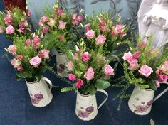 Vintage tin jugs in pink eustoma, pink heaven roses and thalapsi fern, great table centres for a pink theme, country wedding