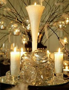 Centerpiece using jars and vases filled with Epsom Salts (inexpensive, looks like snow and the heat from candles does not have any effect on them.  Add glitter to the snow for added sparkle, pine cones, ornaments, red berries anything for an elegant centerpiece)