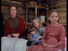 Caroline Ingalls with her daughters, Carrie, Mary and Laura.