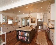 Lovely kitchen.  Note the cabinets OVER the windows--great to display crystal or glass.