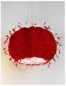 "Just for fun (and something totally unexpected), hang a ""Red Cumulus"" lamp in front of the bathroom mirror—two for the price of one! ABYU (And Bob's Your Uncle) Lighting makes it from red feathers with a white and red diffuser at the bottom."