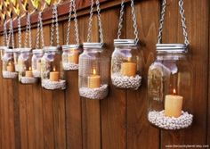 outside lighting -I made a ton of these for my garden party. They looked so nice at night when lit. I used epson salt instead of rocks. And used jute to tie around the mason jars