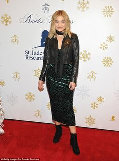 Eye-catching: Olivia Holt's velour dress featured baroque dark green patterns swirling inside matching diamonds