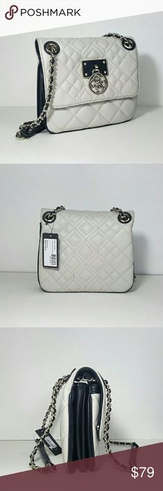 "Guess Aliza Flap Crossbody With its quilted faux leather, this fashionable handbag is perfectly suited for year-round wear.  Features:   *GUESS Quattro Lining *Snap Closure *Exterior features pale shiny gold-tone hardware *Front shows the iconic GUESS Quattro logo charm *Interior has 3 accordion compartments; 2 frontwall slip pockets, 1 middle slip compartment and 1 zippered backwall pocket. *Convertible chain strap with 21? drop length  Dimensions: 8.75""W x 7""H x 3""D Style: VG610921 Color…"
