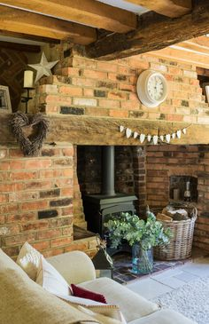 Inglenook fireplace and original beams in 17th-century home