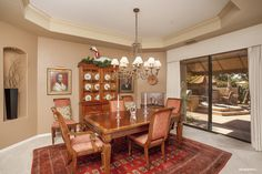Gainey Ranch home for sale in Scottsdale, Arizona. Enjoy a family dinner in this dining room.