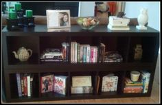 Bookshelves behind  couch.