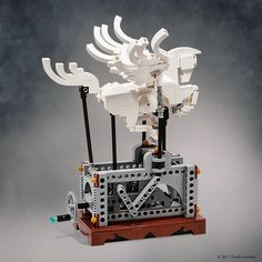 This Lego sculpture is impressive. It isn't that the design is elegant and graceful; full of curves, which is very hard to do with Lego. It's that the whol Lego Design, Lego Technic, Lego Steampunk, Steampunk Design, Lego Gears, Technique Lego, Lego Sculptures, Amazing Lego Creations, Lego Animals