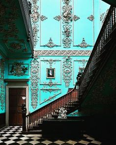 Blue walled stairwell at Powderham Castle, which came into the Courtenay family. (@whitingwhatnow)