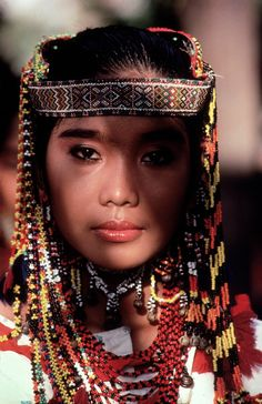 PHILIPPINES. Banaue. 1985. A tribes woman in native attire © Steve McCurry