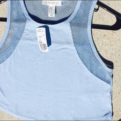 NWT F21 Mesh Paneled Semi Crop Very cute cut, I just should've ordered a S for myself :( I paid 6.90 plus shipping so price is firm  Forever 21 Tops Tank Tops