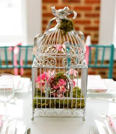 Lets Feather Their Nest Baby Shower   (The Enchanted Florist in Alexandria, VA built amazing floral arrangements in a collection of bird cages. Their website: http://www.enchantedfloristoldtown.com/index.php)