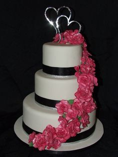 hot pink wedding cake. I would want the navy ribbon to be turquoise