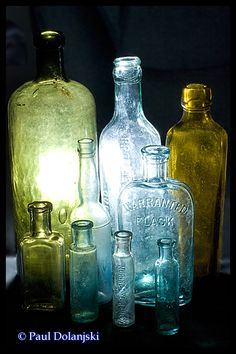 Vintage bottles, I love the shapes and colors and the backlit photography is awesome!
