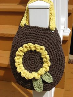 "Sunshine on My Shoulder Bag Crochet Pattern Pdf: Advanced beginner/intermediate If you enjoy flowers as much as I do,then you'll love making one of these! It's such a bright and cheery accessory,and a great bag to have for summer : ) Finished bag measures: 14"" x 14"" Finished Sunflower measures: A big beautiful 7 1/2"" in diameter This pattern also contains directions for making a 18"" shoulder length strap,as well as a 9"" handbag length.Your choice. Bag is worked with 2 strands held together…"