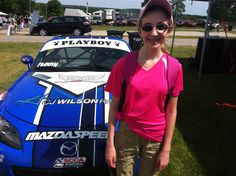 Daughter Meg thought this Mazda racer was cool. They even let her sit in it.