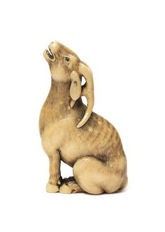 A A VERY FINE IVORY NETSUKE OF A STAG By Okatomo, Kyoto, late 18th/early 19th century Sold for US$ 271,564 inc. premium THE HARRIET SZECHENYI SALE OF JAPANESE ART 8 Nov 2011. Bonhams