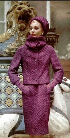 1962 Model in a lovely purple stone-wool suit with high-neck collar by Jacques Heim,