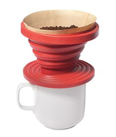 One-Cup Coffee Brewer.  Pop the collapsible silicone funnel on top of your mug, then add a filter, ground coffee, and hot water for a single serving of your morning brew. Love this for travel....I prefer porcelain for the home. I found fine grind works best :)