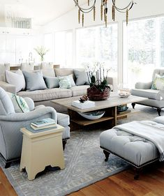 Traditional living room - pale blue, an English arm club chair with exposed legs and nailheads for a change of pace. Classic and comfortable seating - popular for good reason.