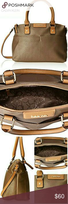 """Calvin Klein Hudson Satchel Make room in your closet for this Chic Calvin Klein Hudson bag. Bronze leather body with camel top rolled handles and shoulder strap. Gold and leather monogrammed CK badge. Double front and back exterior slip pockets. Zip top. Footed. Interior CK signature lining with back wall zip and accessories pockets. Gold tone hardware. 12.75 W x 1p H x 5.75 D Handle drop 6"""". Strap drop 13"""". Excellent condition. Calvin Klein Bags Satchels"""