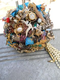 bouquet made of trinkets from your life.  i would like a scaled down version of this