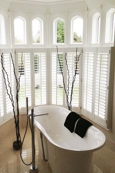 Cafe style shutters are ideal for ground level windows and town houses, Cafe style leaves the top of the window un-shuttered, using only shutters for the bottom part. Outside Shutters, Bay Window Shutters, White Shutters, Interior Shutters, Living Room Decor Gallery, Living Room Designs, Cafe Style Shutters, Room Layouts, Window Styles