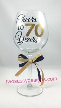 This wine glass will make a striking and unique anniversary or birthday gift for the casual wine drinker or wine connoisseur. This is sure to be a one of a kind keepsake to add to their glass collection. Our wine glasses are gift boxed to match and ready to take to the celebration. Makes a unique gift idea for:  Birthday, Wedding Anniversary, Work Anniversary, and High School or College Reunions   :: LISTING INCLUDES ::  ~ One 20 oz. stemmed wine glass  ~ Cheers to 70 Years applied with a…
