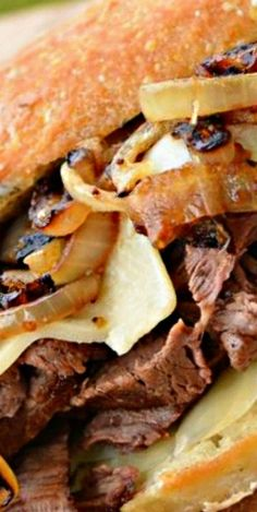 Steak and Cheese with Fried Onions Sandwich - Flavorful steak with sweetness from onions, some melted cheese and a kick of garlic.