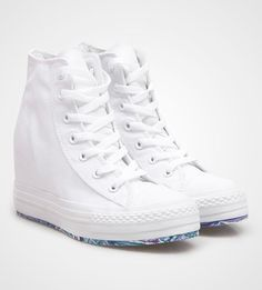 The Chuck Taylor Platform Plus features a hidden internal wedge that is 2.5 Inches high. This style also features a marbled outsole. White sneakers wedges with a blue sole details, make this so unique, perfect for casual style. http://www.zocko.com/z/JGtko