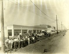 Laborers laying rails for the Pacific Electric Car Line in Van Nuys, California, 1914. Los Angeles Valley College Historical Museum. San Fernando Valley History Digital Library.