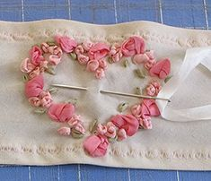 Using silk ribbon to make small roses. At the scientific seamstress site blogspot site.
