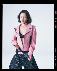 Kiko Mizuhara Jacket and Shorts Louis Vuitton. Bra and Choker Stylist's Own. Photography Nobuyoshi Araki