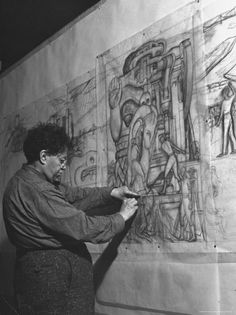 Diego Rivera, creating a fresco: preparing to transfer tracings of his sketches onto the wet plaster  before applying paint.