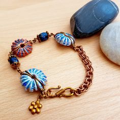 Beach themed bracelet, Shell charm bracelet, Sea lover jewellery, Women's gift, Beach gift, Ocean bracelet, Sea shell jewellery, handmade by SweetgemsDesign on Etsy