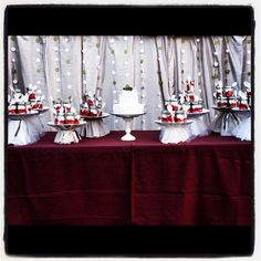Cake table! Strawberry shortcake in mason jars! Cake stands are made from old vases all found at the good will with a charger glued to the top covered in muslin and tulle!