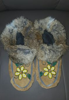 Hand beaded #vamps. # hand stitched moccasins.  Suede and rabbit.