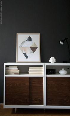 Mid century modern cabinet made from Ikea Besta shelf unit in living room with dark walls