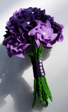 "Felt Flower Wedding Bouquet <--- I dig the pearl accent to them and love how they did the stems and ""wrap"". hmmm"
